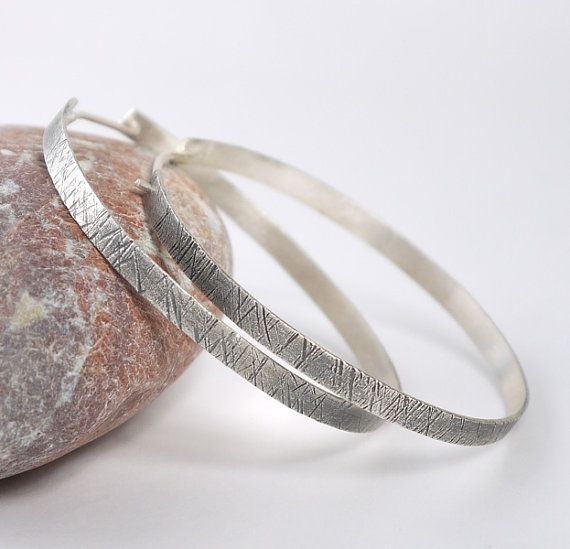 Hammered silver earrings hoops with a charcoal patina surface. Large striking, oxidized silver hoops.Lightweight hoops.