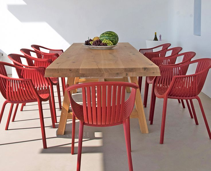 red chairs exterior dinning wooden table island life