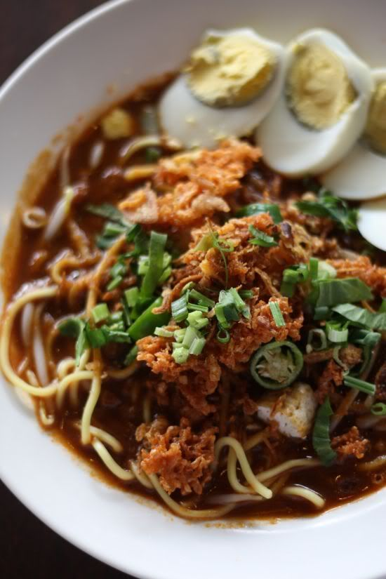 Singapore Street Food - Malay yellow noodles in thick gravy or Mee Rebus. Typical breakfast food found in hawker centers.