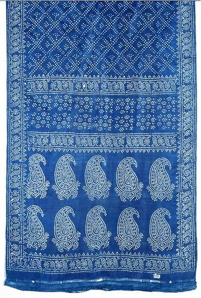 Sari, c 1880, India, Berhampur. 'Berhampore silk', whether raw or manufactured, referred to products from four different local centres which were marketed at Berhampore (modern Baharampur); it was then a substantial industry. Tie-dyeing and its printed imitations are no longer produced in West Bengal. In 1882, this sari was probably resist-dyed.