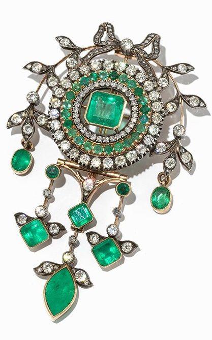 A Belle Epoque emerald and diamond brooch, Russian, circa 1900. The circular…