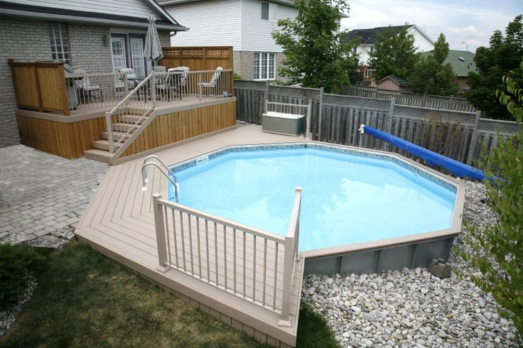 This 2 level deck was built by Hickory Dickory Decks using composite decking and cedar skirt and aluminum railings.