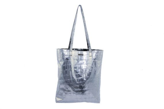 Lend a touch of sparkle to your accessories collection with MONAO silver shopper bag. Neatly sized for shopping trips, traveling and more, complemented