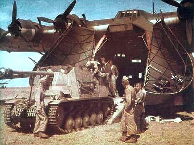 Marder II leaving a giant Messerschmitt German transport plane.