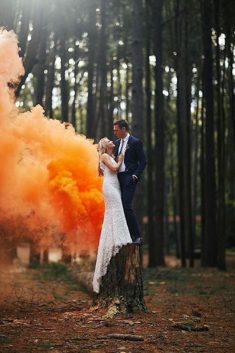 forest wedding with orange smoke bomb