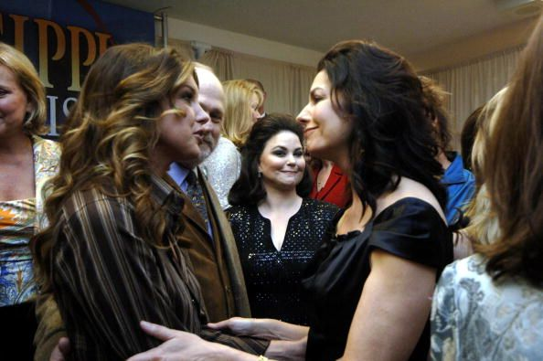 Faith Hill talks with Sela Ward during Mississippi Rising a benefit for Hurricane Katrina victims on October 1 2005 in Oxford Mississippi