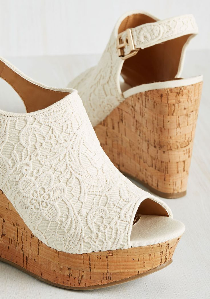 Both alluring and elegant, these white wedges by Report Footwear bring out the romantic in us all! As ideal for a ramblin' road trip as they are for an engagement dinner, these fabric platforms flaunt peep toes, slingback heels, and lace-like embroidery that prompts immediate infatuation.