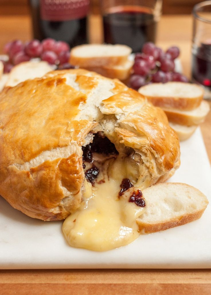 """Baked brie in puff pastry takes """"rich and luxurious"""" to a whole new level — I can think of few things better. Add a few friends and some good tunes playing in the background, and you've got yourself a bonafide party situation. Here is everything you need to know."""
