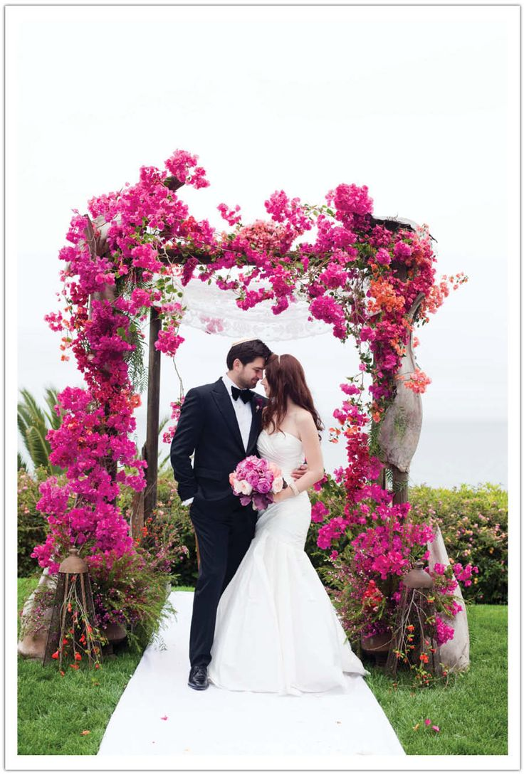 I can't get enough of this vibrant bougainvillea chuppah executed by Krista Jon.  Design by Alchemy Fine Events