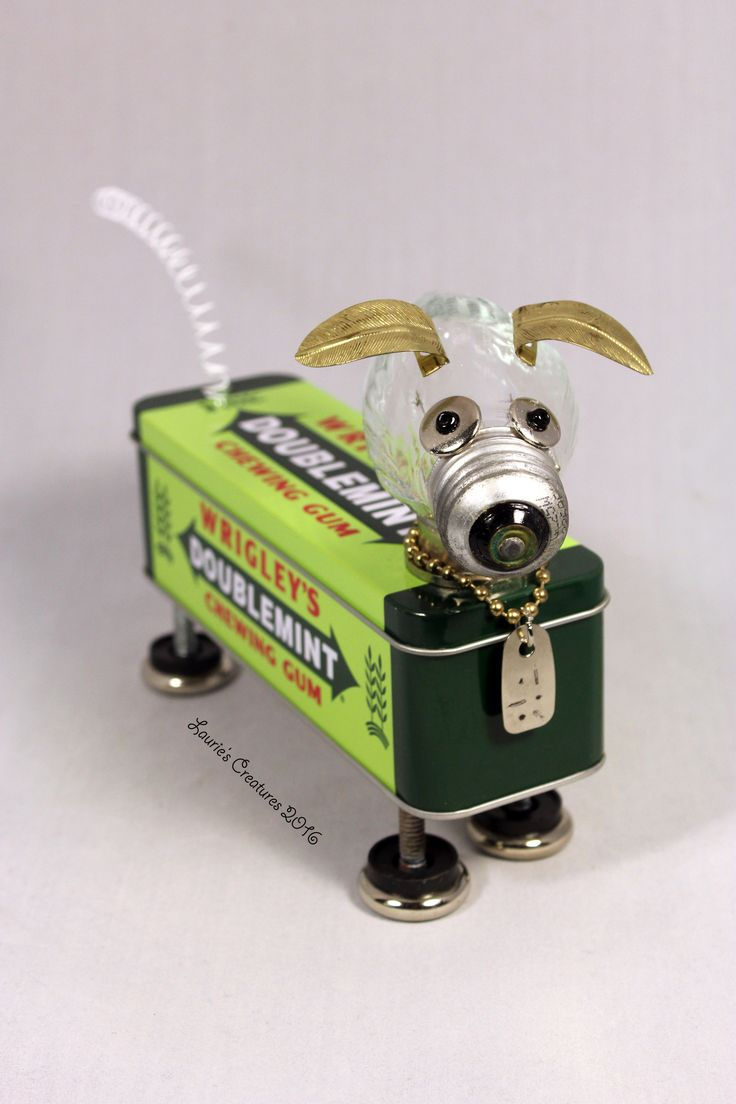 """Wrigley 2"" ~ Found object junk art dog created by Laurie Schurer in 2016. The tin opens to store small treasures inside. To purchase one of Laurie's Creatures go to https://www.facebook.com/LauriesCreatures."