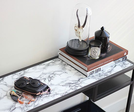 If cutting straight lines isn't your forte, you'll appreciate this ​faux marble table tutorial.