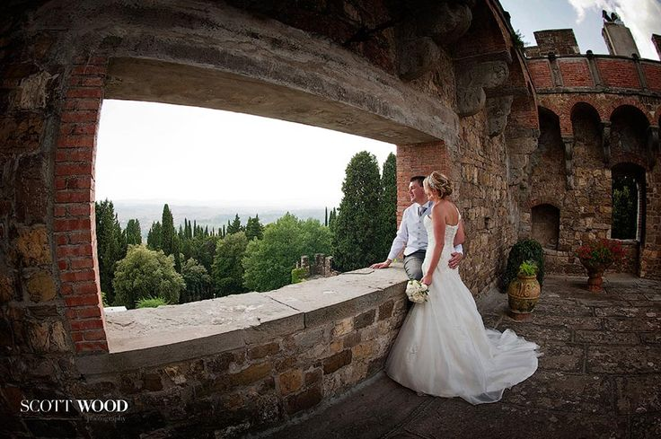 Destination wedding photography in Tuscany. A stunning 'picture' window looking out from Castello di Vincigliata toward Florence