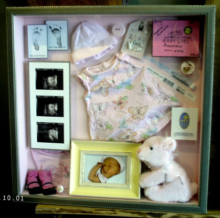 Baby memory box with ultra sound photos and foot prints.