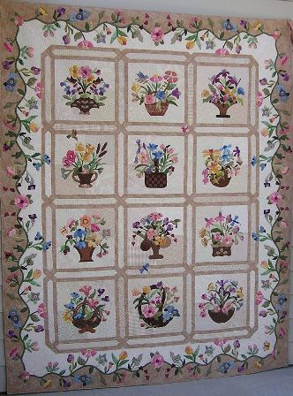 I have been working on the quilt for several of years.  I only have the flowers on the border to go.