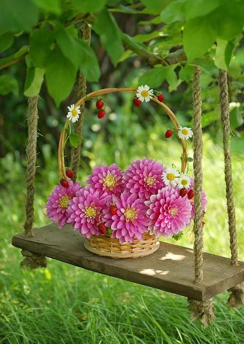 A simple pretty basket of vibrant natural blooms brightens a corner of the yard!