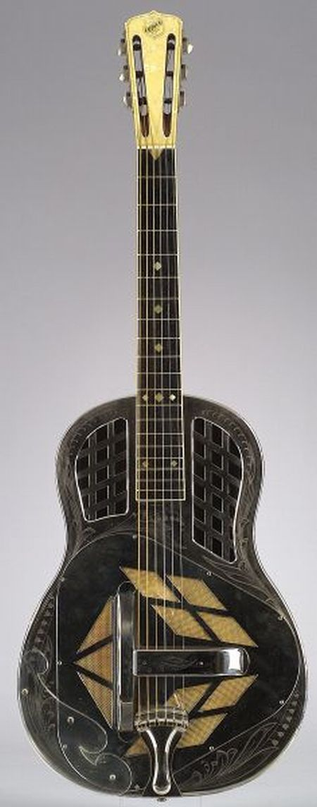 American Resonator Guitar, National String Instrument Company, 1929, Style 3, Tricone, serial number 0932, the nickel silver plated body engraved with a lily-of-the-valley motif, the round neck, the bound ebony fingerboard with square pearl inlay, the pearloid overlaid peghead engraved NATIONAL.