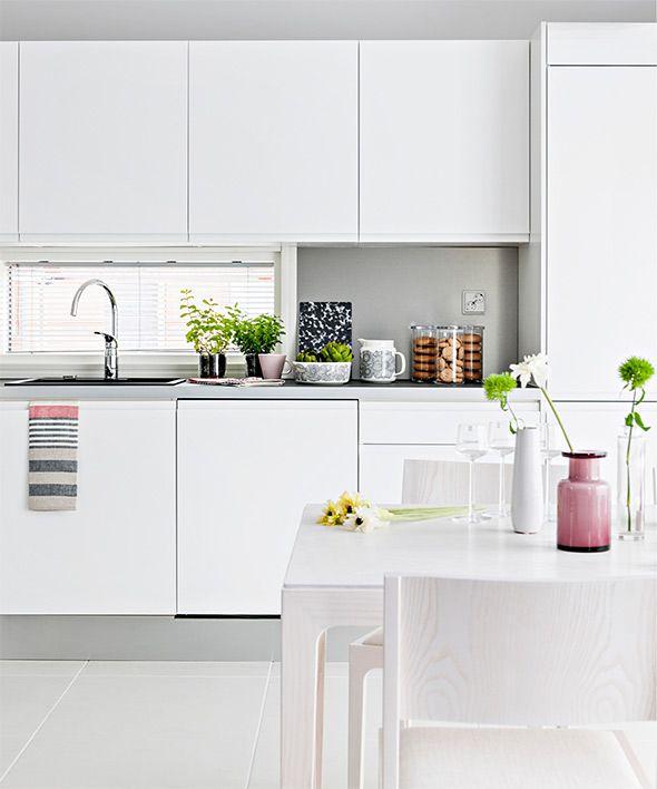 All white kitchen via Ellit. Photo by Pauliina Salonen.