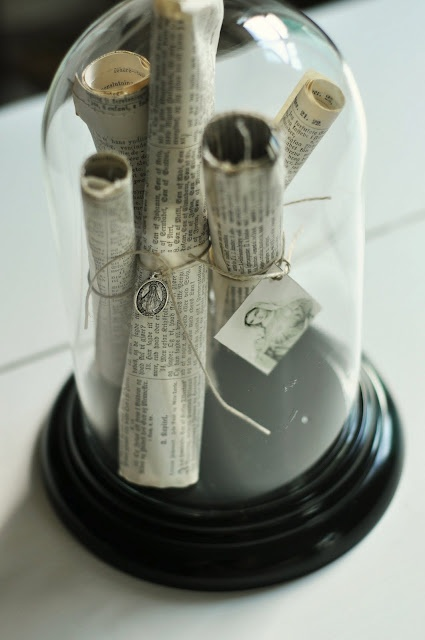 cloche with copies of documents and picture