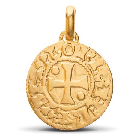 Ce pendentif est une reproduction du Denier de Beauvais, monnaie d'Hugues Capet datant du Xème siècle.