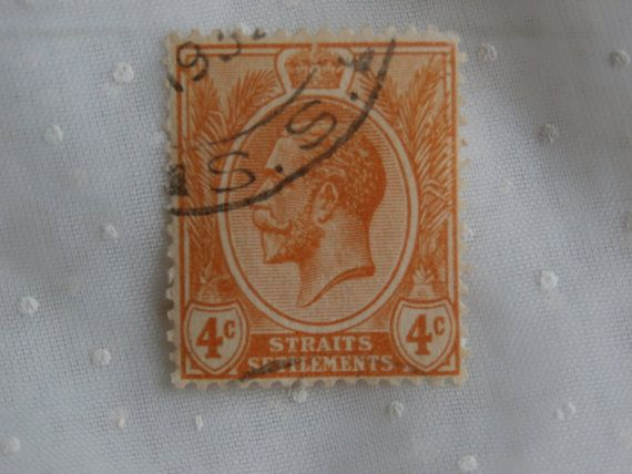 1930s Straits Settlements 4 C Stamp King George V.  Postmarked 1932.  Orange-ish color.  A pretty and old stamp for your collection or crafting.