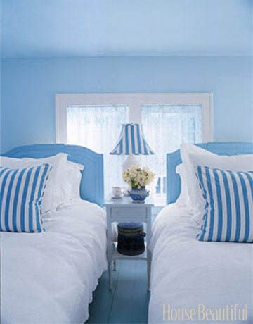 A Clean and Crisp Guest Room Designer Valerie Smith used antique oversized twin beds for this guest bedroom. The blue and white palette creates a crisp and simple look. Featured in the March 2006 issue.