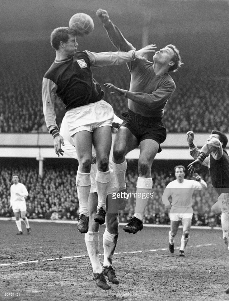 13th February 1965. West Ham United striker Geoff Hurst jumps for a high ball with Everton goalkeeper Gordon West while team mate John 'Budgie' Byrne waits for any mistake.