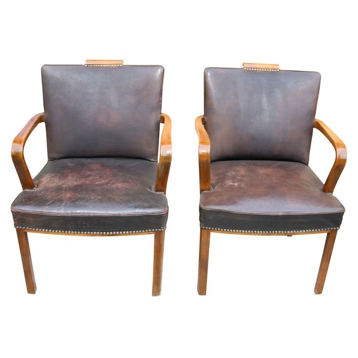 pair of dark brown leather armchairs