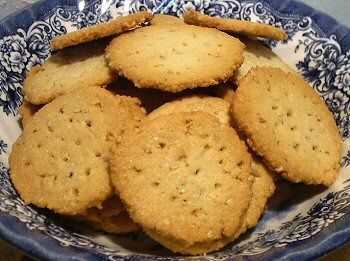 """BUTTERY SESAME CRACKERS  3 ounces almond flour, 3/4 cup  2 teaspoons granular Splenda  1 egg white  3/8 teaspoon salt  1/8 teaspoon garlic powder  1/8 teaspoon onion powder  3 teaspoons untoasted sesame seeds  2 tablespoons butter, softened    Mix all ingredients well in small bowl. Chill dough about 30 min. Drop dough by 1/4 t onto a parchment-lined 12x17"""" baking sheet making 24 little piles leaving at least an inch between. Pick pieces of dough up one at a time very gently roll into balls."""