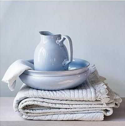 blue ceramic bowl and pitcher with quilt