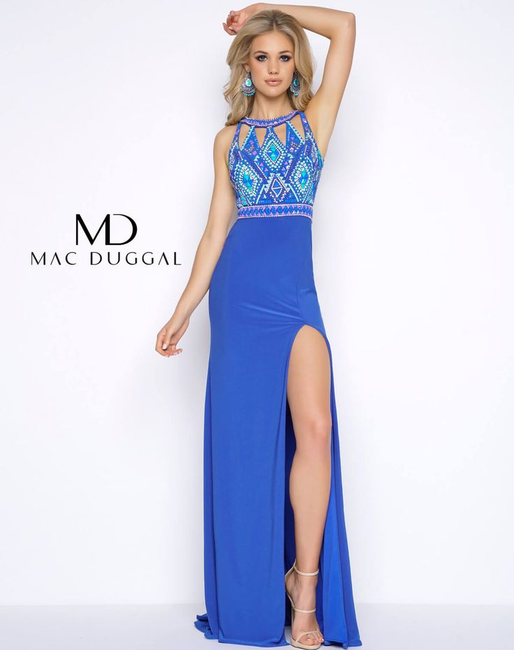 Aztec beaded halter neck column jersey prom dress with high slit and open back. Available in Aztec Blue or Black Multi.