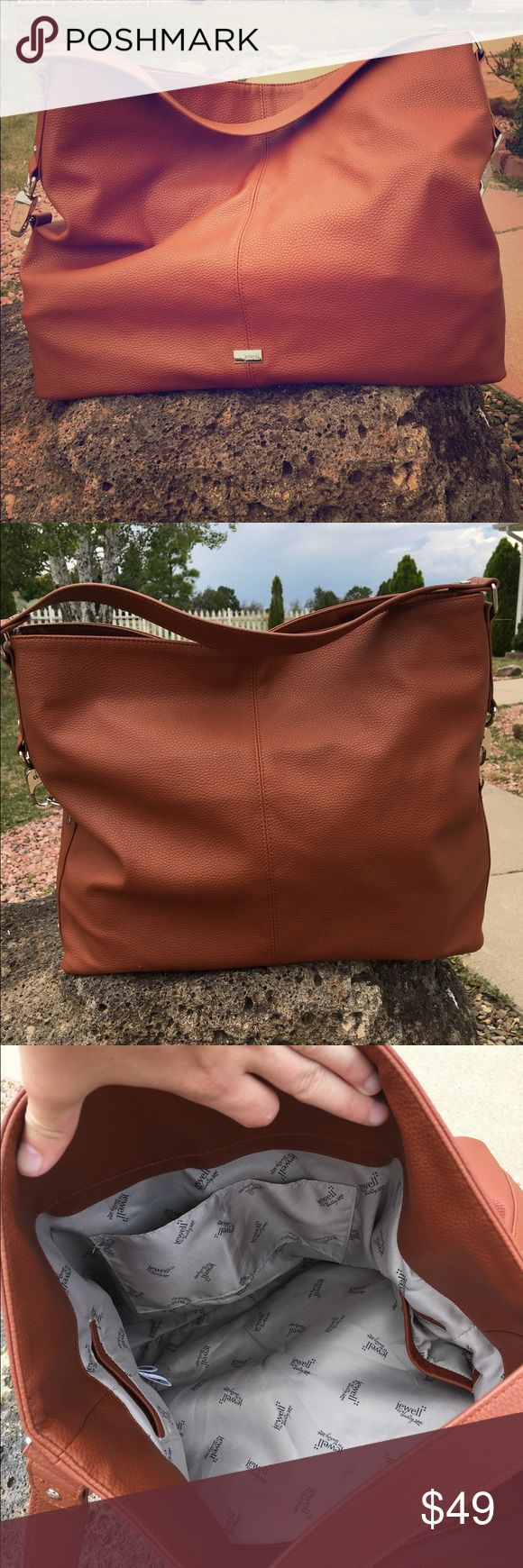 Cognac Jewell 'Fashion Games' Hobo Bag (NWOT) Brand new faux leather hobo bag with lots of space and interior pockets. Large enough for a laptop and can also be used as a super trendy weekender bag. Jewell by My Thirty-One Bags Hobos