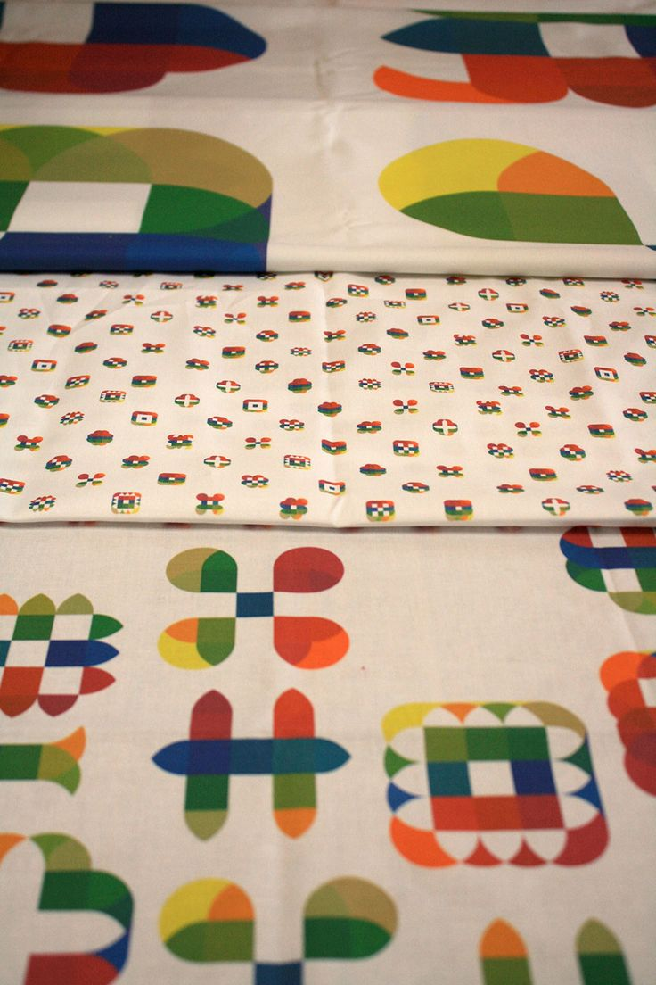 Blip is a colorful, modular, ornamental alphabet with many dingbats. It is here printed on fabric to create complex patterns.