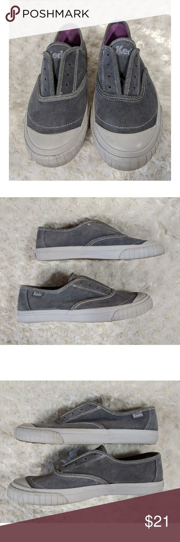 Keds gray leather suede slip on sneakers EUC grey leather suede laceless slip-on Keds.  Elastic is attached to either side of shoe tongue to keep shoe in place. Please view photographs carefully and don't hesitate to ask for more information. Keds Shoes Sneakers