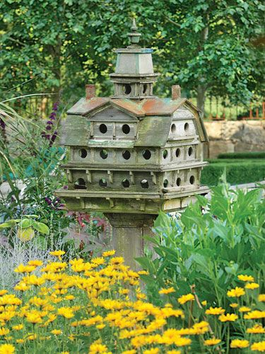 The ornate birdhouse is home to a large flock each year.