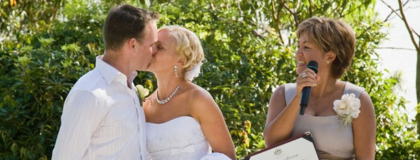 Jodi and Mark Elton share their first kiss as husband and wife  Photo by Jetty Blue Photography