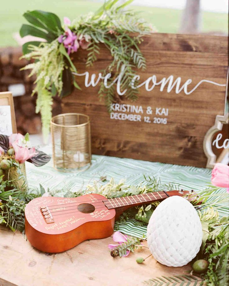A Casual Beach Wedding in Puako, Hawaii | Martha Stewart Weddings - In lieu of a book, guests signed a ukulele at the reception. The eclectic piece was chosen for its Hawaiian roots and ability to double as décor. #weddingideas #beachwedding #hawaiiwedding #weddingguestbooks
