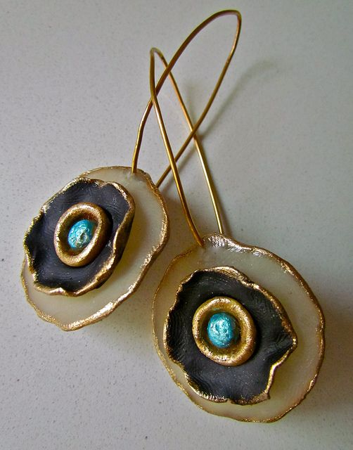 Donna Greenberg Made with black and translucent clay, iridescent powders, and gold leaf.