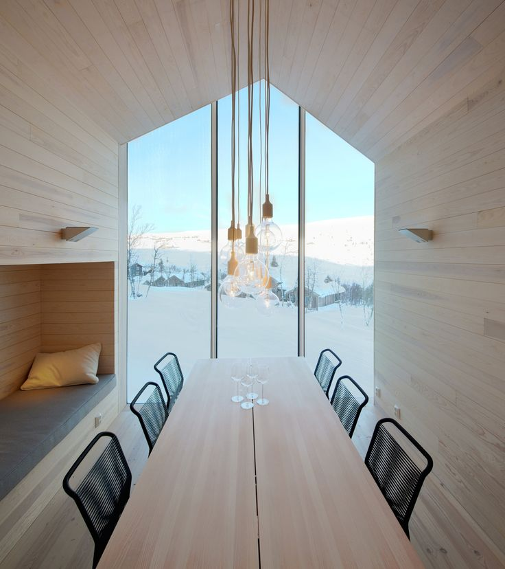Dining room with a view at Split View Mountain Lodge by Reiulf Ramstad Arkitekter. Photography by Søren Harder Nielsen.