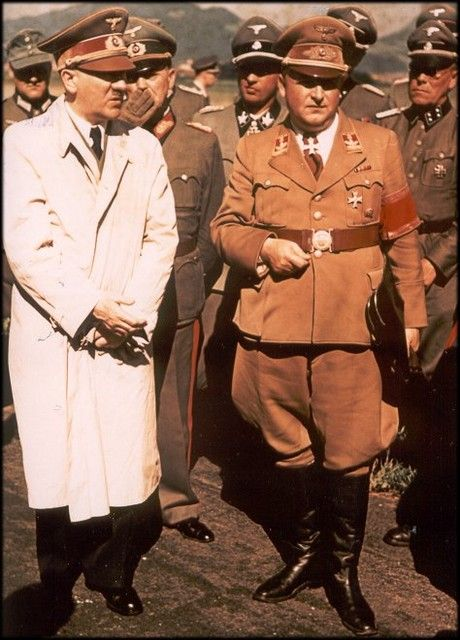 Real color 1943 photo of Hitler. The nauseating Hermann Fegelein in the middle sporting his habitual schmutzig half grin. (via putschgirl)