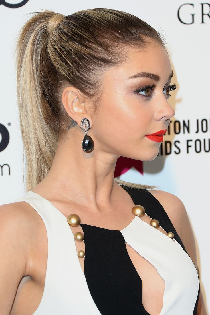 "A simple ponytail but it looks so glamorous! || ""Always rocking bold brows, Sarah Hyland sported bright red lipstick and a high ponytail to the annual Elton John Oscars bash."""
