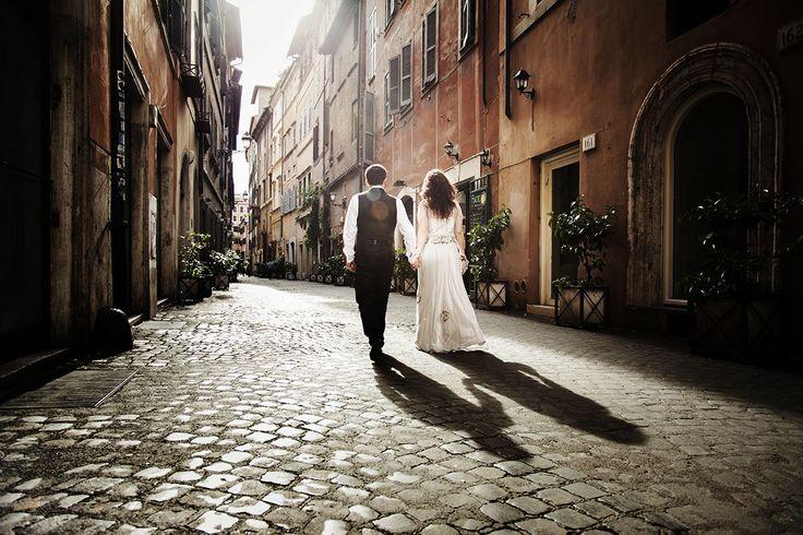 Romantic wedding. Couple walking in ancient roman streets