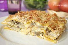 Lasagna ai carciofi e funghi è una lasagna bianca gustosa con scamorza, ricotta, speck e noci.
