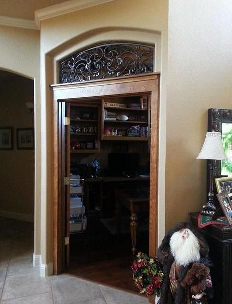 Faux iron in transom above door.