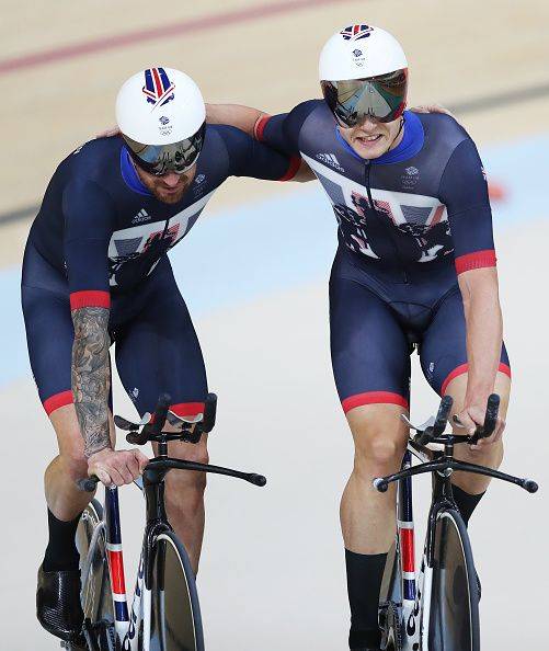 Bradley Wiggins and Steven Burke of Team Great Britain celebrate Gold in the…