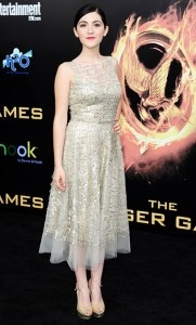 Isabelle Fuhrman (Clove) at The Hunger Games L.A. premiere, wearing an Oscar de la Renta dress, Blue Nile jewelry, and Jimmy Choo shoes.