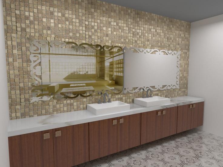Banheiro com espelho diferenciado, pastilhas na parede e piso em mosaico.