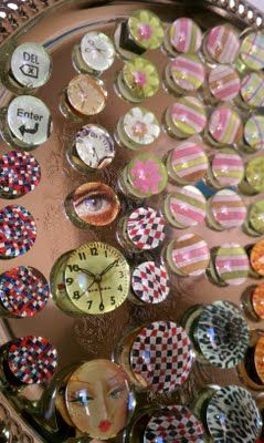 Homemade magnets from clear marbles!  Mom got some for Christmas, and I was jealous.  So making these.