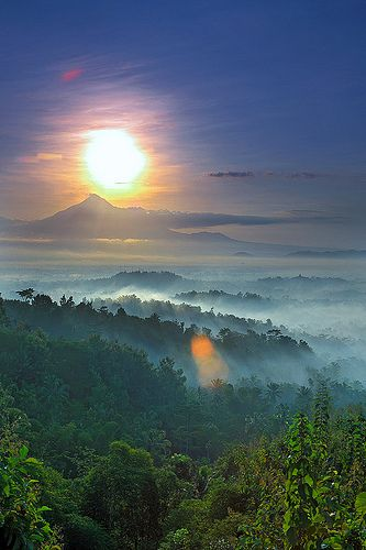 Sunrise View of Merapi volcano from Setumbu. Borobudur Temple can bee seen in the right side. Indonesia