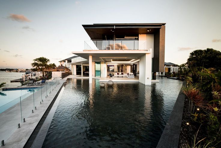 here The Lagoon House is situated at Pacific Harbour's main canal entrance on Bribie Island in Queensland, Australia, and was designed by Robin Payne to reflect its subtropical locale.