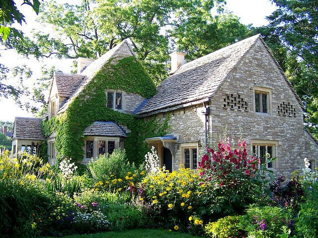 English Cottage with Ivy, Bird Niches and Surrounded by an English Garden home flowers house garden yard cottage english cottage